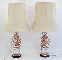 A pair of Chinese  table lamps with silk shades. A