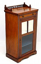 An Edwardian mahogany music cabinet with bevelled
