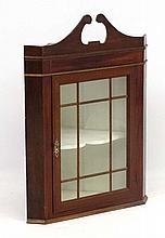 A 19thC mahogany glazed fronted corner cabinet 33