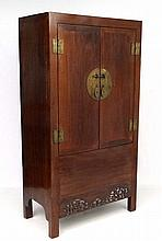 An Oriental hardwood linen press with drawers with
