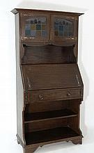 Art Nouveau : An oak bureau cabinet with stained