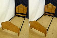 A pair of c.1900 single spruce pine beds with