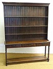 An early 20thC oak open dresser with barley twist