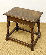 A c.1700 oak joint stool with turned and banded