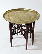 An early 20thC Indian brass circular topped table