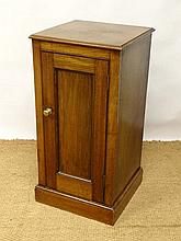 A late 19thC walnut panelled single door bedside