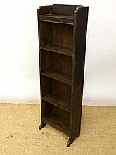 A 1920's oak narrow floor standing bookcase with