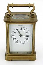 Carriage Clock : a 5 bevelled glass brass cased