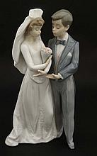 A Lladro figure group modelled as a Bride and Groo
