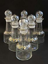 A set of 6 20thC  bottles / small decanters and st