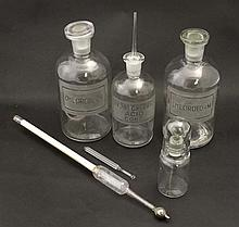 Two glass chemist / apothecary bottles labelled ch