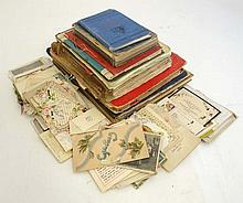 A collection of early 20thC postcards, scrap books