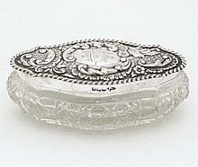 A cut glass dressing tale pot with HM silver lid