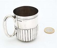 A HM silver mug with fluted decoration and loop