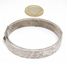 A HM silver bangle formed bracelet with engraved