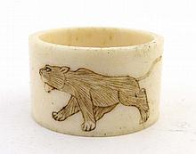 An early 20thC carved bone napkin ring with image