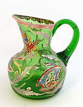 A c.1900 green glass jug with hand painted enamel