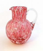A c.1890 Spatter glass jug with clear glass handle