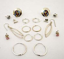 A large quantity of assorted earrings , hoops