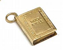 A 9ct gold charm formed as a Holy Bible 5/8