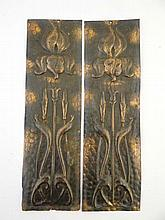 A pair of Art Nouveau embossed coppered finger