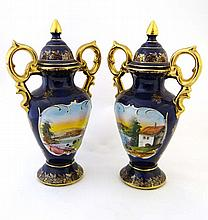 A pair of baluster shaped covered vases having
