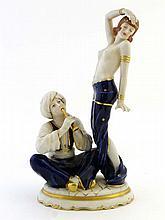 A Royal Dux Art Deco figure group depicting a half