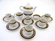 A Miniature Tea Set, white china with gold gilt