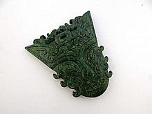 Jade : a spinach green Jade carved human mask