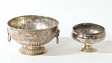 A silver plate punch bowl with floral decoration