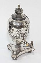 A Victorian silver plated tea urn with goats head