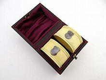 A pair of early 20thC cased ivory napkin rings