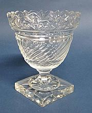 A pedestal glass celery vase with star cut square