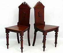 A pair of 19thC mahogany hall chairs 36 1/2