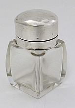 A glass salts bottle with silver mounts and hinged lid. Hall