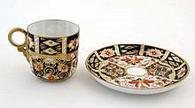 A Royal Crown Derby Imari pattern 2451 coffee cup and saucer