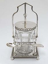 A silver plate preserve stand with central glass jar and ass