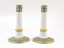 A pair of 19thC porcelain candlesticks having