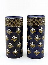 A pair of cobalt blue tapered vases, having white