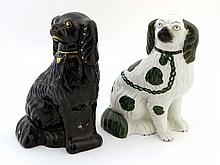 A Victorian Staffordshire spaniel glazed in green