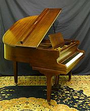 A German baby grand piano by Steinbach , of