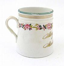 A Victorian Porcelain Mug, gold gilt motto which