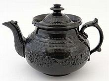 A Victorian black smear glazed teapot having