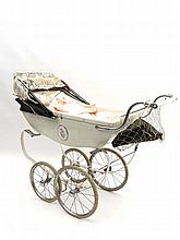 Pram & Doll : A Silvercross pram with Floral side