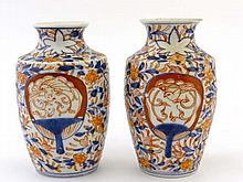 A pair of Japanese Imari vases having tapered