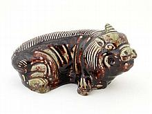 A Chinese pillow figure of a recumbent pig