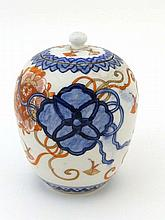 A Japanese ginger jar and cover decorated in Imari