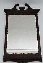Wylie & Lochhead Ltd Glasgow : A mahogany Chippendale Revival wall mirror with fretted detail and swan neck pediment 23