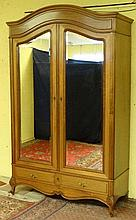A French 2-door mahogany armoire having shaped bevelled edge mirrors to doors and doors opening over 2 short drawers ( L