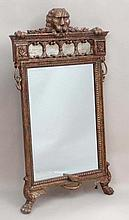 A Contemporary 19thC style gilt framed bevelled edge wall mirror, the top with lions mask and paw holding laurel over ca